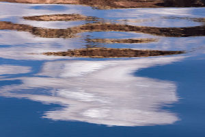 Abstract design of canyon wall and sky reflections, Glen Canyon National Recreation Area