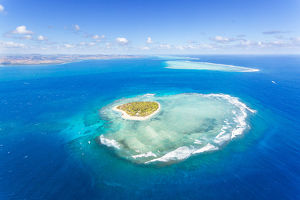 Aerial view of heart shaped island Tavarua, Fiji