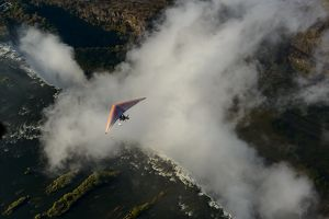 Aerial view of a micorlight (ultralight) flying over the Zambezi River and Victoria Falls