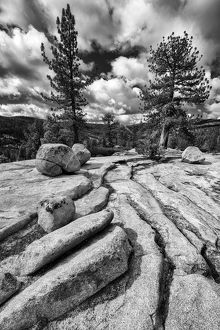Black and white image of granite outcropping with boulders, Yosemite National Park