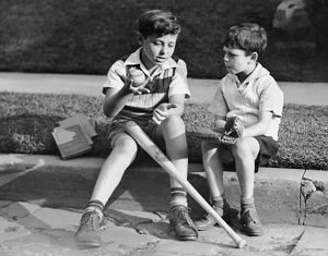 Two boys playing baseball
