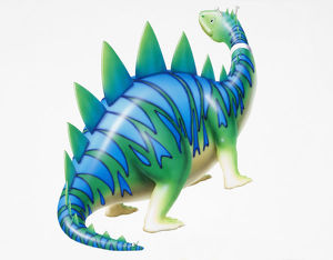 Cartoon character depiction of green dinosaur with blue stripy skin and spikes, side view