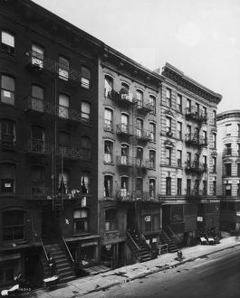 circa 1935: Exterior view of tenement buildings along Ridge Street on the Lower East Side