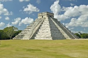 White puffy clouds over the Mayan Pyramid of Kukulkan (also known as El Castillo)