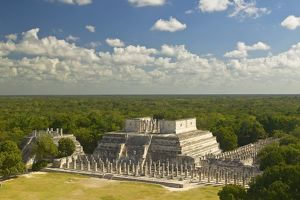 'A panoramic view of the Temple of the Warriors out of jungle at Chichen-Itza