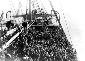 Coming To America; Immigrants pack the upper deck of the liner SS Patricia as it
