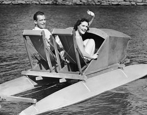 Couple on lake in paddle boat