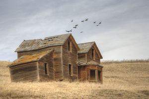 A derelict ranch in a prairie setting