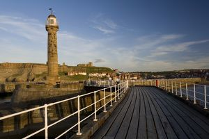 England, North Yorkshire, Whitby, pier and lighthouse