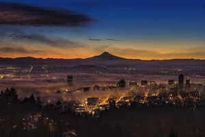 Fog rolling in at dawn over the city of Portland