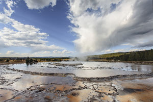 Great Fountain Geyser in Lower Geyser Basin on sunny day, Yellowstone National Park