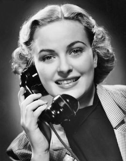 Indoor portrait of woman on telephone