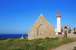 Lighthouse Phare de Saint-Mathieu in ancient ruins, in the Finistere, Brittany, France