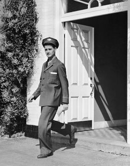 Man in uniform walking out door