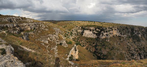 travel/unesco world heritage/panorama view prehistoric rock dwellings gravina