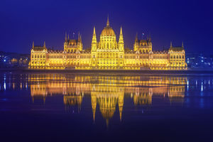 The Parliament of Hungary with the Danube river (Budapest, Hungary) in the night