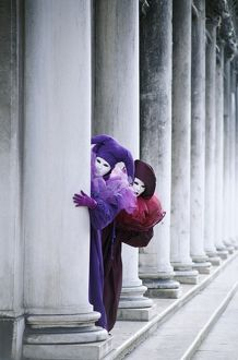 Two People in Carnival Costume Hiding Behind a Column, Venice, Italy, Europe