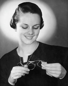 Portrait of woman cleaning eyeglasses
