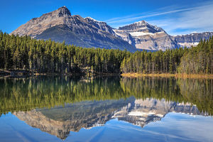 travel/unesco world heritage/rocky mountains reflected herbert lake banff