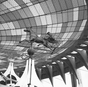 Sculpture of chariot under glazed roof, (B&W), low angle view