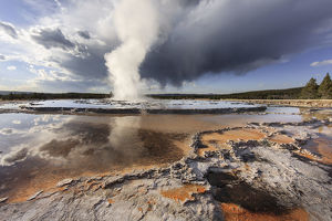 Stormy clouds over Great Fountain Geyser, Yellowstone National Park, Wyoming, USA