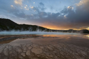 Sunset with steam rising from Grand Prismatic Spring, Yellowstone National Park, Wyoming