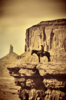 Wildwest Coyboy on Horse in Old Retro Antique Sepia Tone