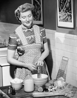 Woman mixing ingredients in bowl