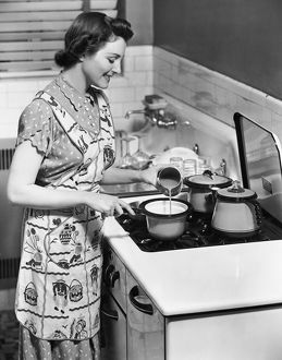 Woman preparing food on stove