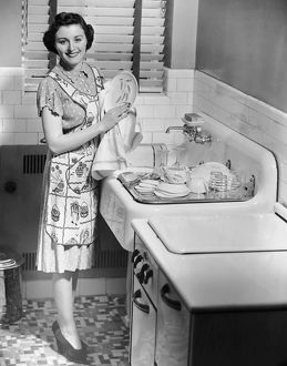 Woman at sink washing dishes