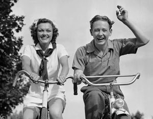 Young couple riding bicycles