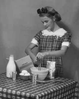 Young woman preparing food