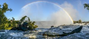 The Zambezi River and rainbow just above The Eastern Cataract. Victoria Falls. Livingstone