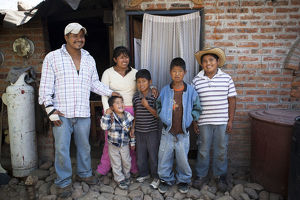 Antonio, 11 years old, on the right, with his family outside the