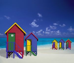 Colourful Bathing Cabins on Tropical Beach