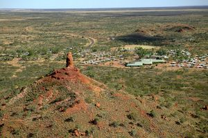 The Monument rock pillar and township beyond.