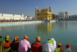 Quiet contemplation at the side of the holy lake Sarovar, looking at the Harmandir Sahib