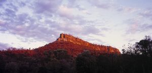 A sandstone bluff at sunset,