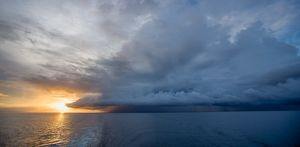 Tropical storm at sunset over Mapia Atoll,