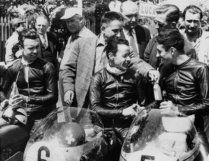 The 1st, 2nd and 3rd seen in the paddock after winning the 125 cc TT race on the