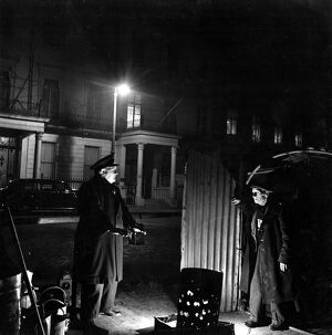 29 March 1952 Bill Howard a Romany night watchman in Belgrave Square, talking to