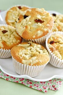 Apple struesel muffin in pile on white plate credit: Marie-Louise Avery /