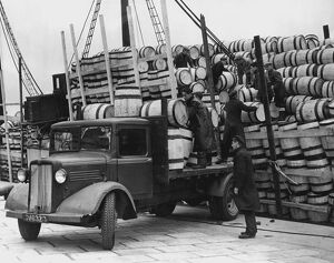 Barrels for the Shetland catch of herring being unloaded at Lerwick, 1949