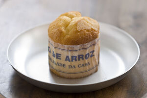 Classic Portuguese muffin type cake made with rice in paper wrapper on metal plate
