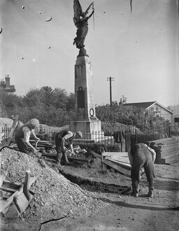 The construction of an Air Raid Precautions shelter beneath a war memorial in Swanley