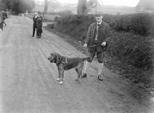 Dog detectives. Man hunting trials at Savernake. Mr Theo Crowder and his famous