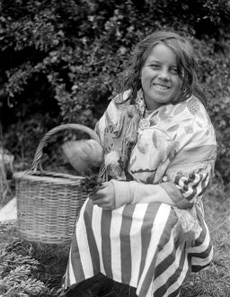 Gypsy girl with her basket of lucky heather . Late 1940s , early 1950s