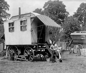 A gypsy woman sitting on the steps to her Romany caravan in the gypsy camp on Epsom Downs