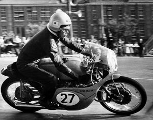 Isle of Man: One of the Japanese team members T Tanaka speeds round thes maller Clypse