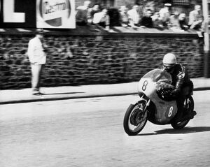 Isle of Man: Jim Redman pictured at speed on his new four-cylinder Honda during the